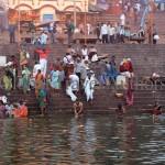 India, travel, Asia, international, Ceremonial bathing on Ganges River at sunrise, Varanasi, India