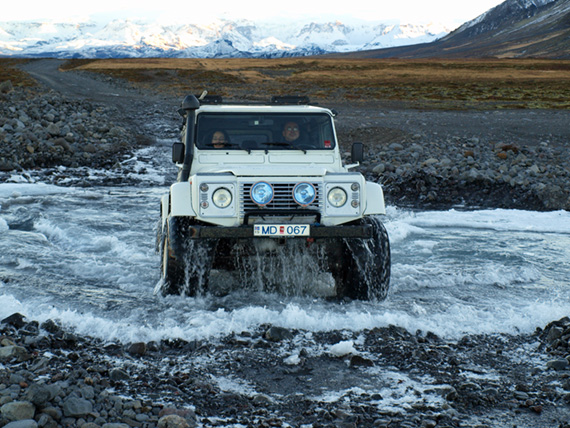 super jeep crossing stream in iceland
