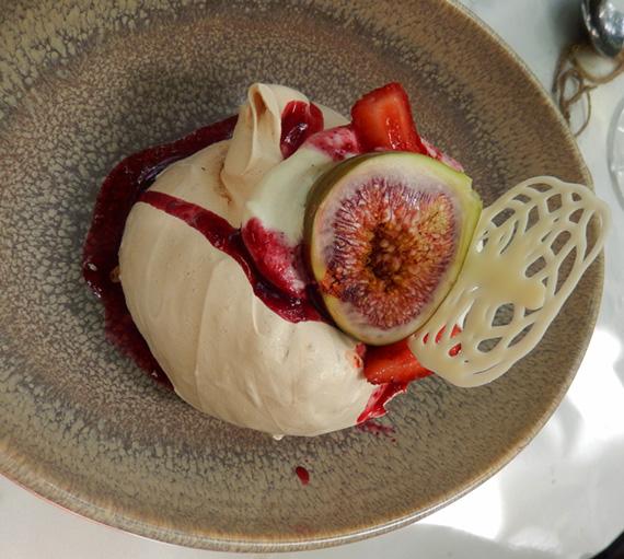 Divine dessert of raw sugar meringue with figs