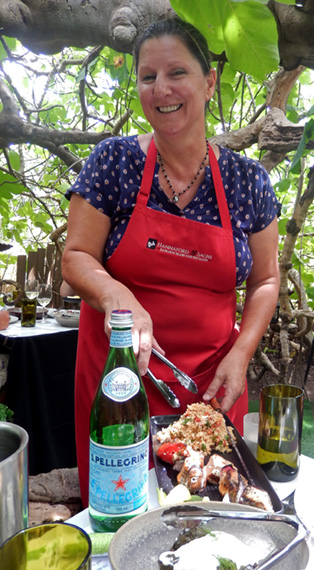 Fig Tree Restaurant owner Sasha Sachs serves salad