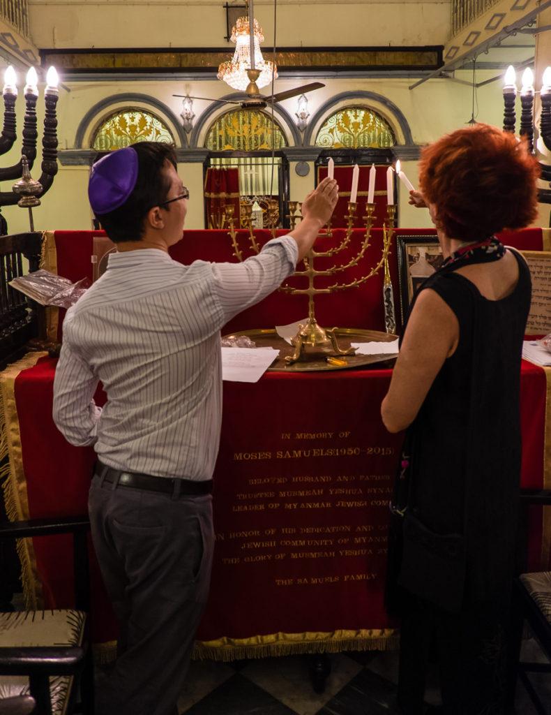 Irene Shaland and Sam lighting menora in the Great Synagogue of  Burma
