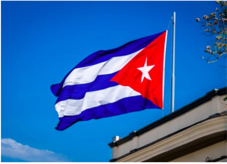 Cuban flag against blue sky