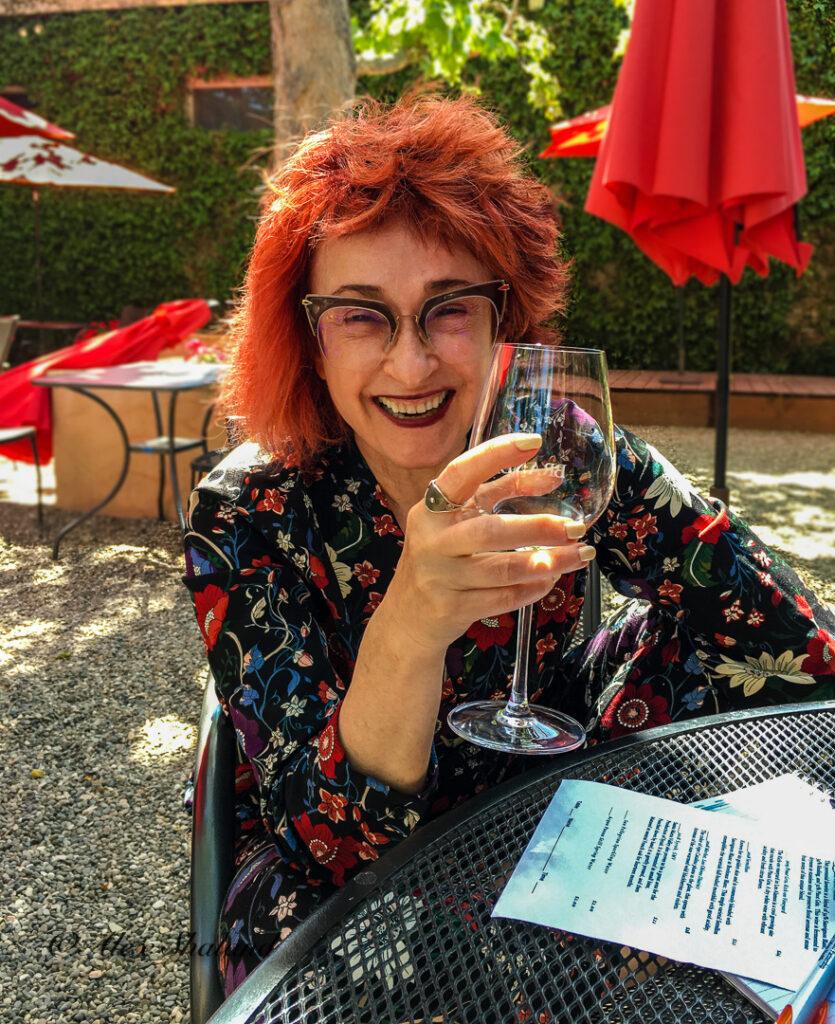 Irene Shaland drinks wine